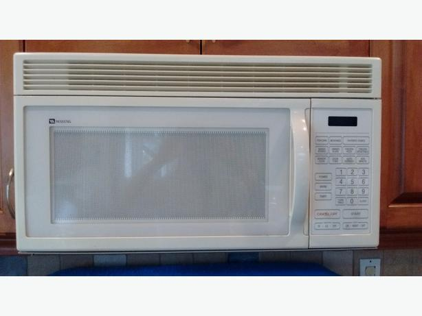 Over the range Maytag microwave