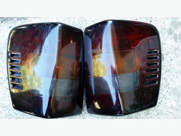 Pair of smoked tailights for 1999- 2004 jeep Grand Cherokee