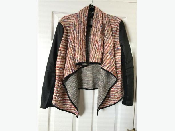 Woman's jacket with leather look sleeves