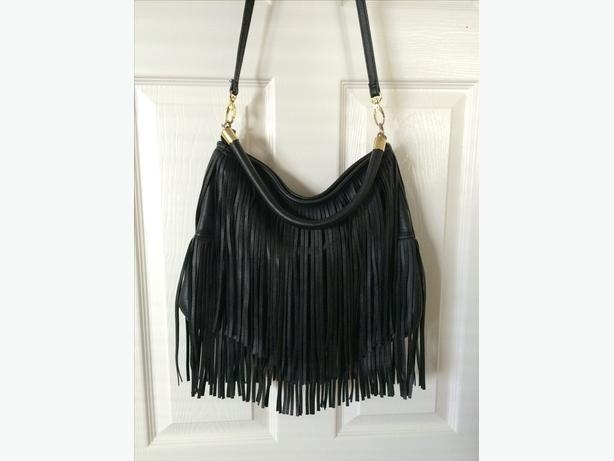 Woman's fake leather tassle handbag