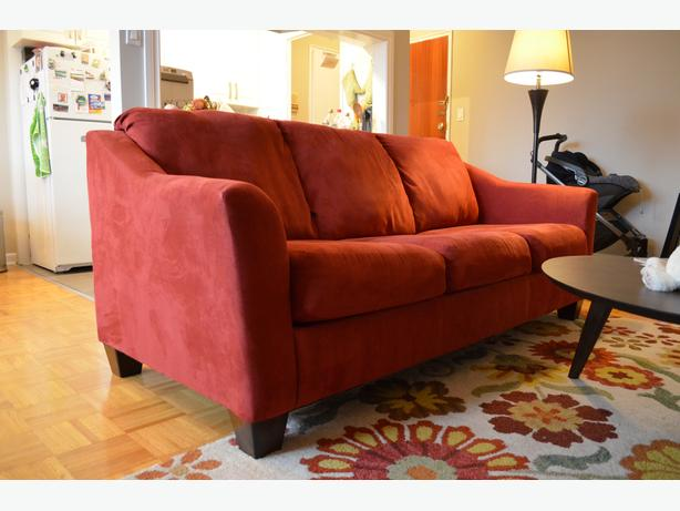 Red sofa with a pullout bed