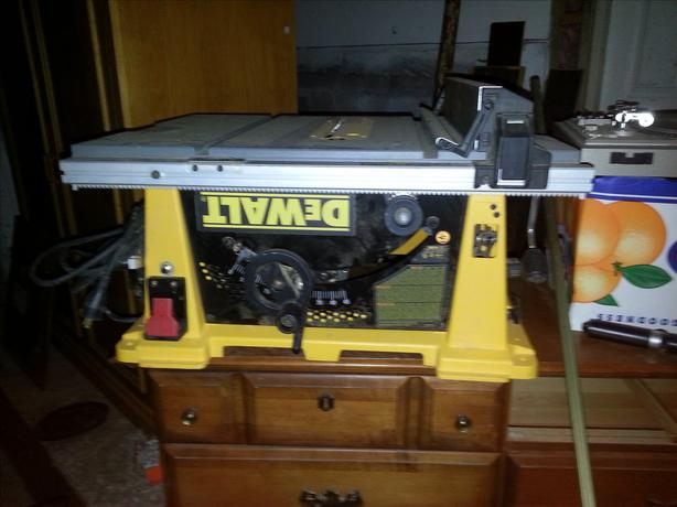 "DeWalt 10"" table saw with two extra blades."