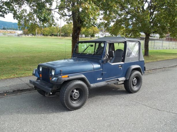1990 JEEP Y J WITH A HARD TOP AND SOFT TOP-CALL HART AT 250 724 3221