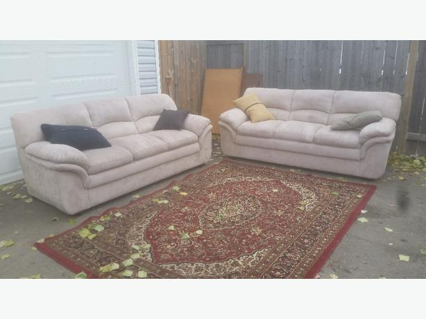 2 matching micro suede couches. delivery is extra