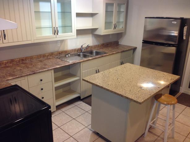 Large, bright & updated 2 bed suite with private laundry and parking