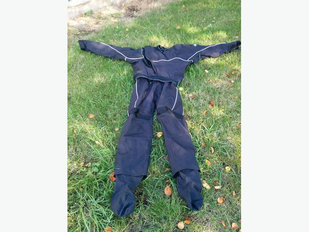Kayak dry suit with spray skirt