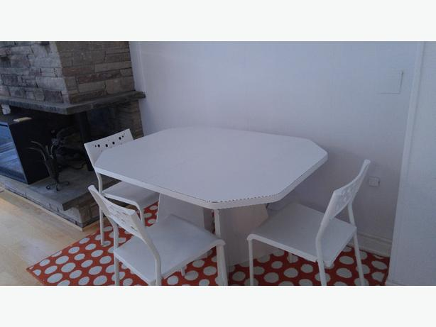 Solid white table and 4 chairs