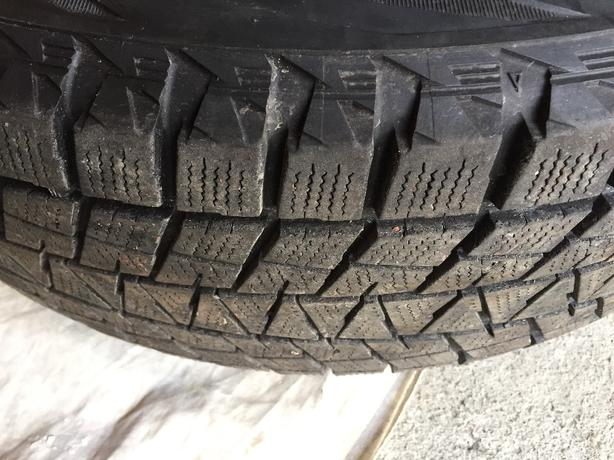 ALMOST NEW BLIZZAK TIRES ON STEEL RIMS