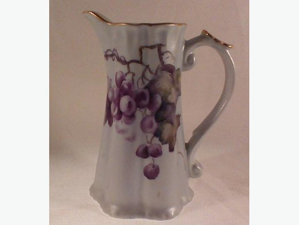 Hand-painted antique porcelain pitcher