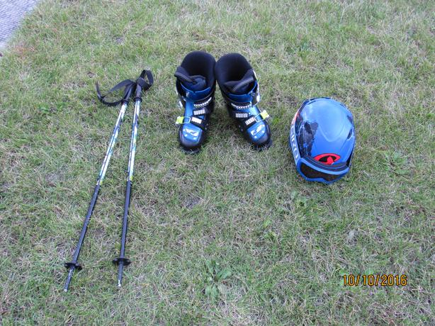 boy's ski set (boots, helmet, goggles and poles)