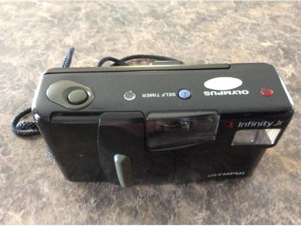 two Olympus 35 mm. Camera