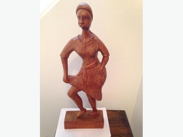 Carved wooden dancing woman from Haiti