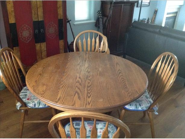 Solid oak pedestal dining room table
