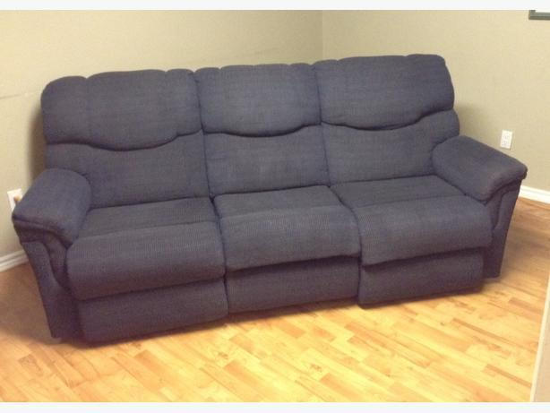 Navy couch with the two ends that have recliners