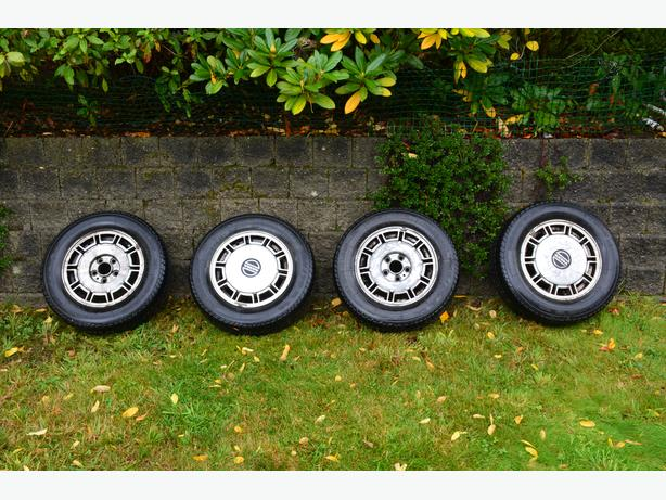Set Of 4 Volvo rims, hubcaps & tires