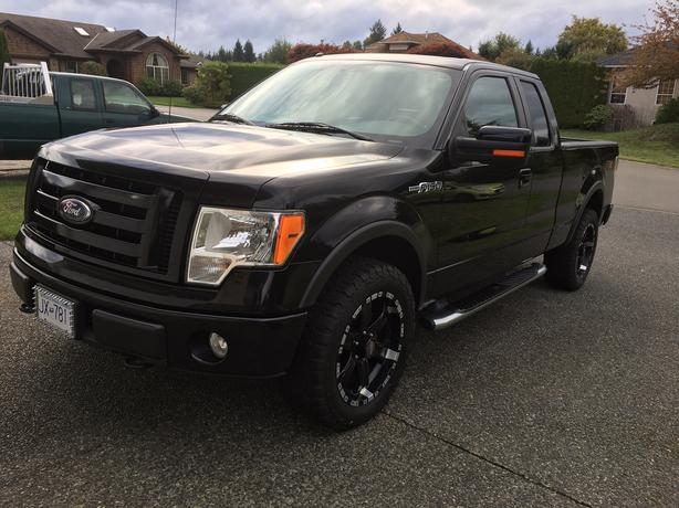 2009 Ford F150 FX4 4x4. Black with black leather. Warranty until Oct 2017