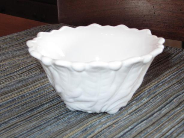 Small milk glass candy dish with feet.
