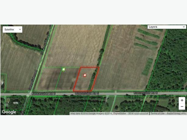 AFFORDABLE BUILDING LOT ON 1.44 ACRES JUST WEST OF ST BERNARDIN!