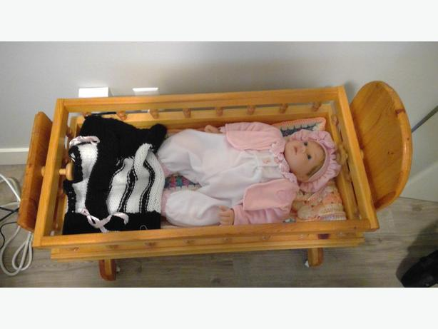 Wood-crafted rocking doll cradle
