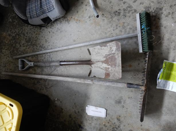 concrete rake, shovel and broom