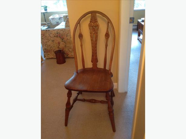 Two walnut carved back Windsor chairs