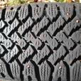 TWO P205/75R15 STUDDED WINTER TIRES