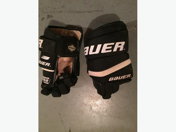 Hockey gloves and right hand hockey stick