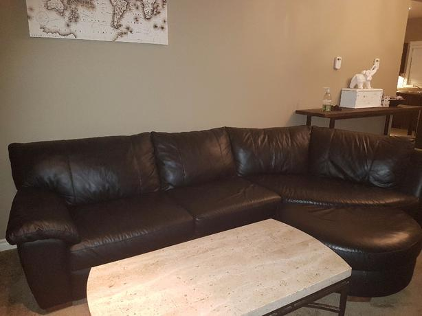 Black leather couch with ottoman