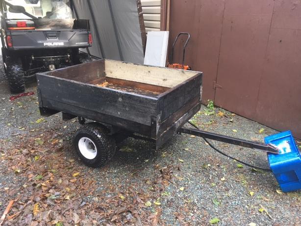 Atv or small tractor trailer.