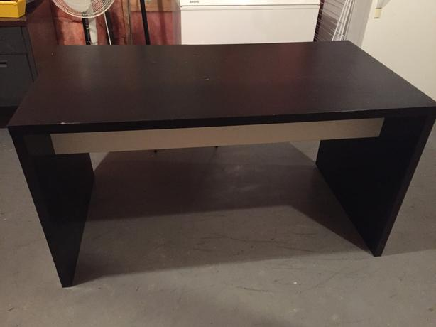 Large brown and black wood desk