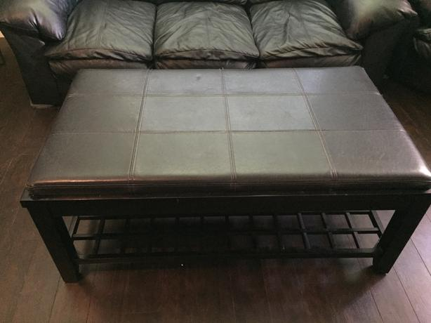 Black leather top and wood base coffee table