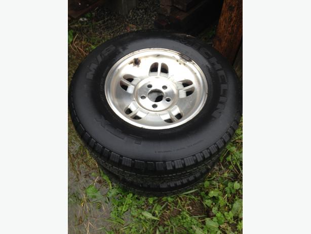 Four 15 inch mud/snow tires