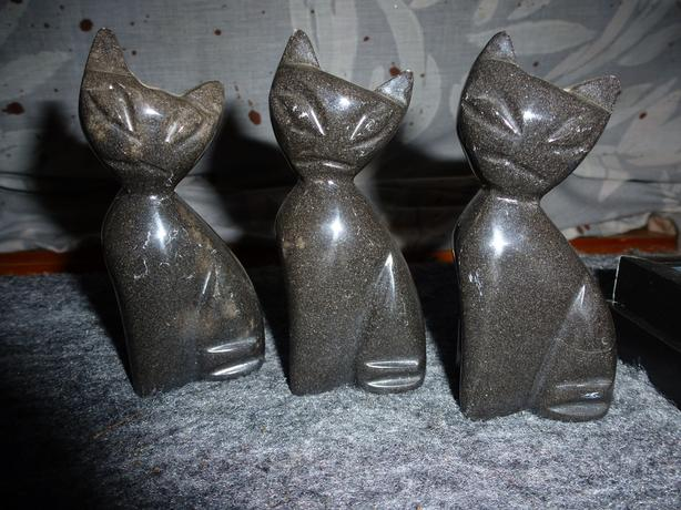 Set of three cat stone carvings