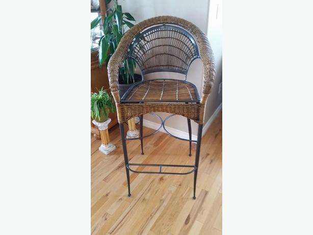 Four Wrought Iron and Wicker Chairs