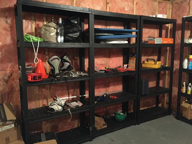 Large black rigid plastic shelving units