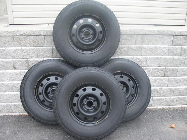 FOUR (4) FIRESTONE WINTERFORCE LT TIRES W/RIMS /LT255/75/17/ - $700
