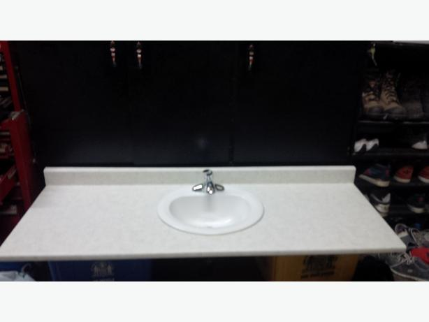 Bathroom vanity top with sink and taps