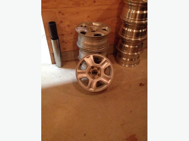 4 Mustang 15 inch rims in very good shape