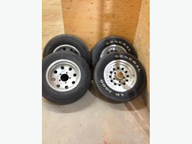 4 15 inch ford aluminum rims with tires