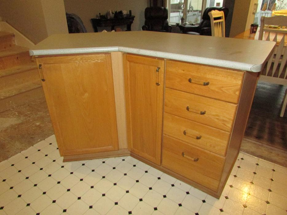 Oak kitchen cabinets with appliances sink and counters for Kitchen cabinets kamloops