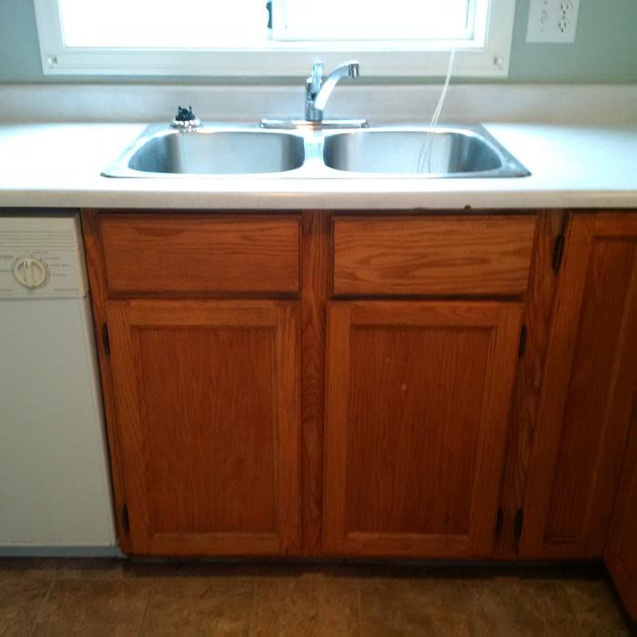 Oak Kitchen Cabinets With Counter Top And Double Sink And