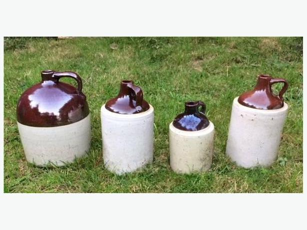 4 early 1900s stoneware liquor jugs - $100