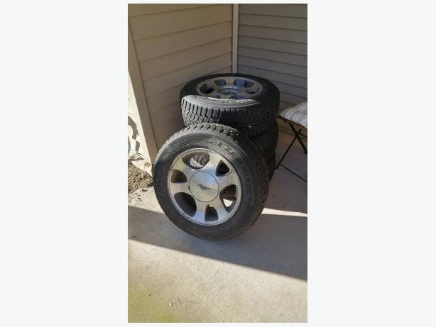 Mustang Snow Tires -- 75% Tread (OBO)