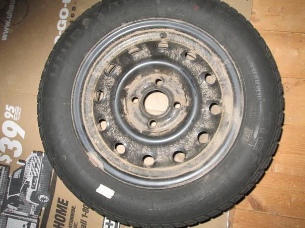 4  185/60R/14 winter tires with 4 hole rims