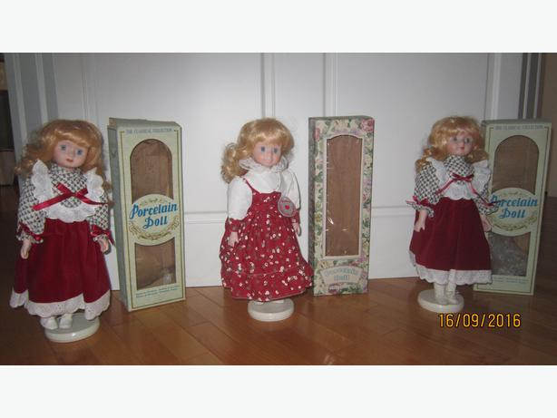 Three Porcelain Dolls with stands
