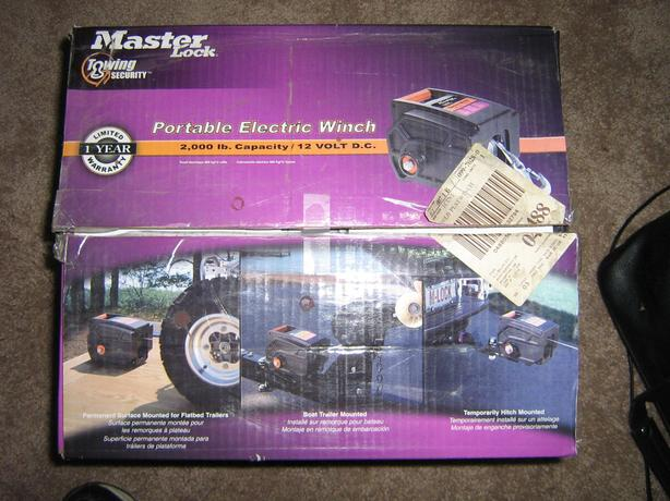 Winch- Master Lock 2,000 pound portable 12 volt electric winch.