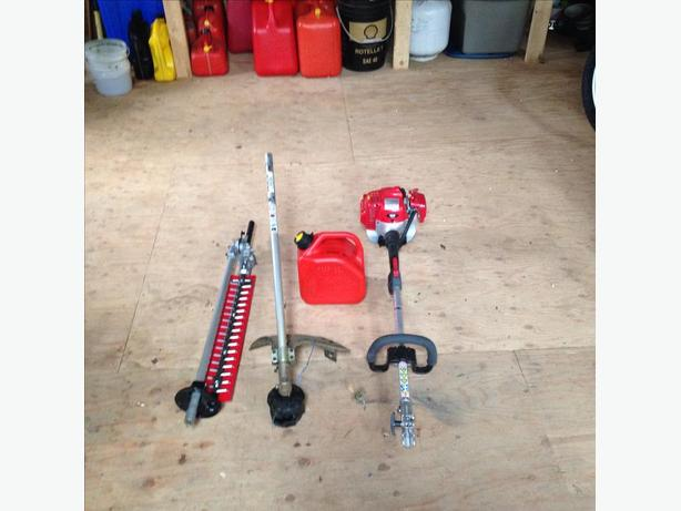 Shindaiwa Powerhead with Weedwacker and Hedge trimmer attachments