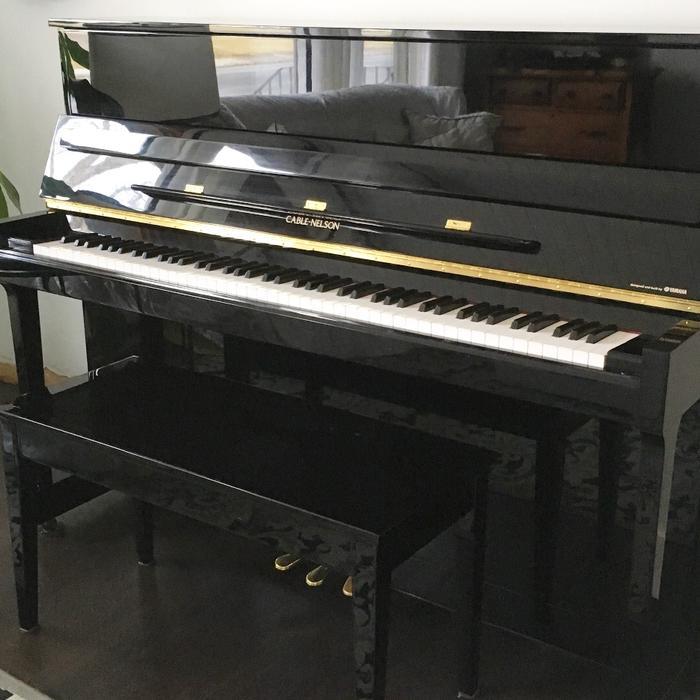 Cable nelson by yamaha polished ebony upright piano east for Yamaha piano store winnipeg