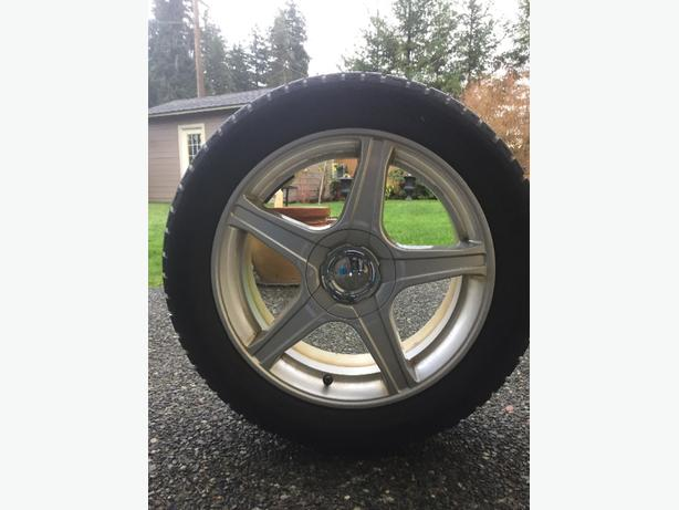 4 Rims and winter tires off Ford Fusion