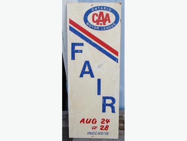 """Vintage 1967's CAA Ontario Motor League 24 X 9"""" Pressboard Sign"""